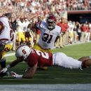 Southern California running back Silas Redd, left, scores past Stanford safety Ed Reynolds on a 1-yard touchdown run in the first half of an NCAA college football game in Stanford, Calif., Saturday, Sept. 15, 2012. (AP Photo/Marcio Jose Sanchez)