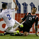 United States' DeAndre Yedlin (2) is stopped by Honduras goalie Donis Escobar (22) during the first half of a CONCACAF Gold Cup soccer match in Frisco, Texas, Tuesday, July 7, 2015. (AP Photo/LM Otero)