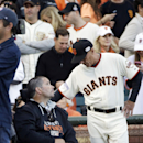 San Francisco Giants fan Bryan Stow talks to Tim Flannery before Game 4 of baseball's World Series Saturday, Oct. 25, 2014, in San Francisco. Stow was disabled after an attack by Los Angeles Dodgers fans following a baseball game between the San Francisco Giants and Dodgers in San Francisco. (AP Photo/David J. Phillip)