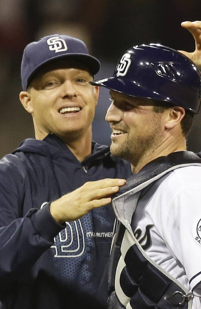 San Diego Padres' Nick Hundley, left, congratulates backup catcher Chris Robinson after the Padres 12-2 victory over the Arizona Diamondbacks in a baseball game Wednesday, Sept. 25, 2013, in San Diego