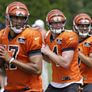 Cincinnati Bengals quarterback Andy Dalton, center, drops back to pass with fellow quarterbacks Jason Campbell, left, and Matt Scott during practice at the NFL football team's training camp, Saturday, July 26, 2014, in Cincinnati The Associated Press