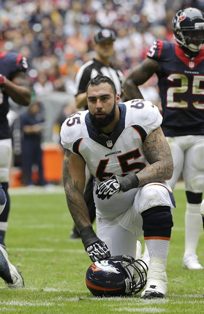 In this Dec. 22, 2013 file photo, Denver Broncos guard Louis Vasquez (65) and Manny Ramirez (66) kneel after a player injury during the first quarter of an NFL football game against the Houston Texans, in Houston