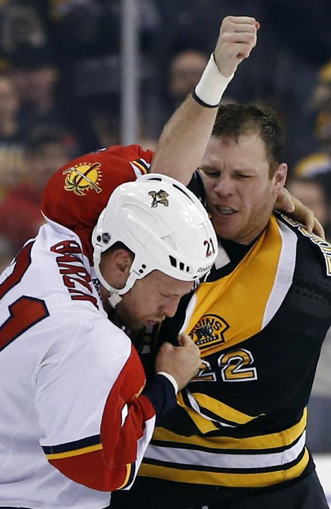 Florida Panthers right wing Krys Barch (21) fights with Boston Bruins right wing Shawn Thornton (22) during the second period of an NHL hockey game in Boston, Tuesday, March 4, 2014