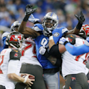 Detroit Lions defensive end Ezekiel Ansah tries breaking through to Tampa Bay Buccaneers quarterback Josh McCown (12) during the first half of an NFL football game in Detroit, Sunday, Dec. 7, 2014 The Associated Press