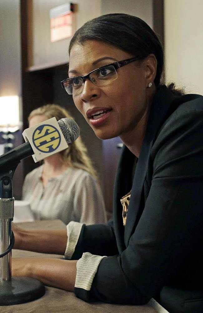 LSU women's coach Nikki Caldwell talks with reporters during the Southeastern Conference NCAA college basketball media day in Birmingham, Ala., Wednesday, Oct. 16, 2013