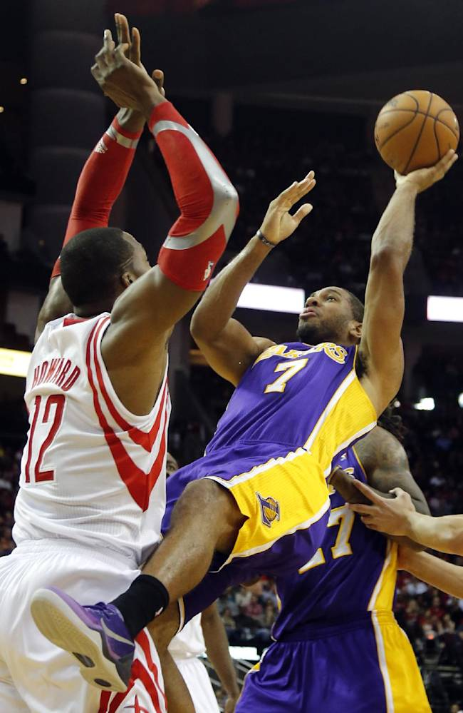 Los Angeles Lakers' Xavier Henry (7) shoots as Houston Rockets' Dwight Howard (12) defends during the second quarter of an NBA basketball game Thursday, Nov. 7, 2013, in Houston