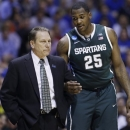 Michigan State forward Derrick Nix (25) talks to head coach Tom Izzo during the second half of a regional semifinal against Duke in the NCAA college basketball tournament, Friday, March 29, 2013, in Indianapolis. (AP Photo/Darron Cummings)