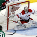 Dallas Stars center Tyler Seguin (91) scores against Carolina Hurricanes goalie Anton Khudobin (31) during the first period of an NHL hockey game on Thursday, Feb. 27, 2014, in Dallas The Associated Press
