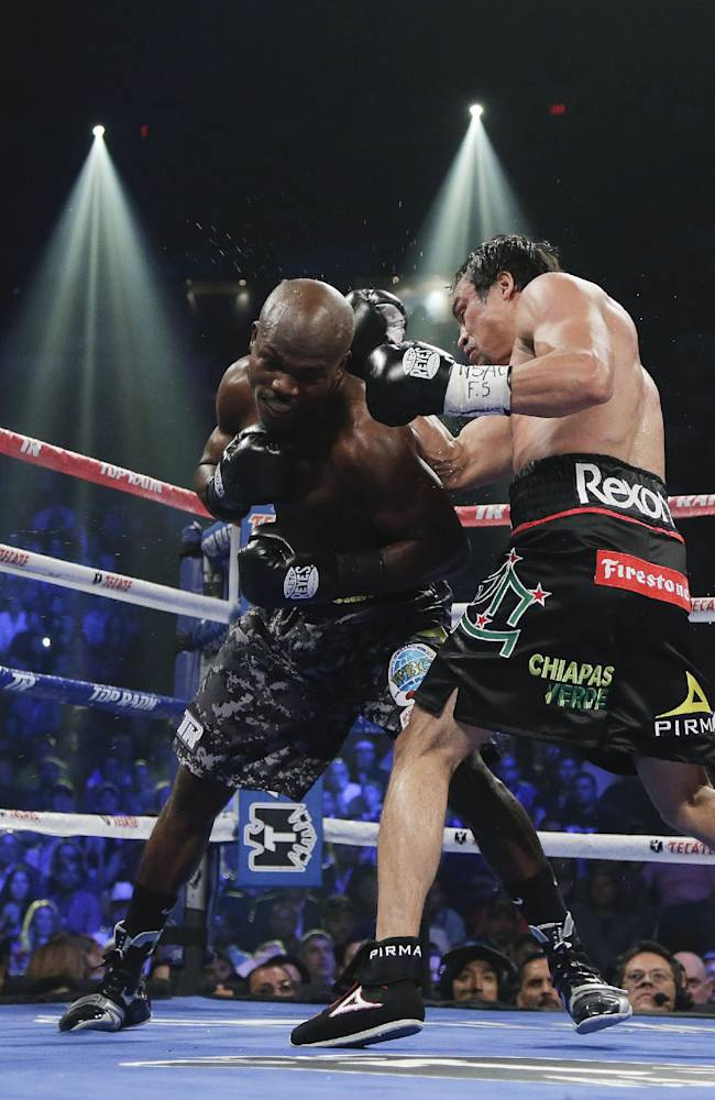 Timothy Bradley, left, exchanges punches with Juan Manuel Marquez in the fourth round during a WBO welterweight title fight, Saturday, Oct. 12, 2013, in Las Vegas. Bradley won by split decision