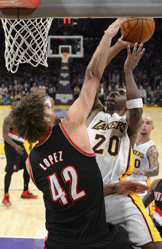 Los Angeles Lakers guard Jodie Meeks, right, puts up a shot as Portland Trail Blazers center Robin Lopez during the second half of an NBA basketball game, Sunday, Dec. 1, 2013, in Los Angeles
