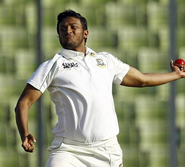 This is a Wednesday, Jan. 29, 2014 file photo of Bangladeshi cricket player Shakib Al Hasan as he bowls on the third day of the first test cricket match against Sri Lanka in Dhaka, Bangladesh. The Bangladesh Cricket Board has on Monday July 7, 2014 suspended all-rounder Shakib Al Hasan from all competitions for six months and forbidden him from playing overseas until the end of 2015 due to his