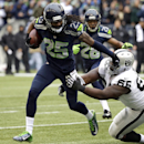 Seattle Seahawks cornerback Richard Sherman (25) pushes aside Oakland Raiders' Gabe Jackson after Sherman made an interception in the first half of an NFL football game, Sunday, Nov. 2, 2014, in Seattle The Associated Press