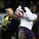 West Ham United's James Collins, left attempts to clear the ball as Everton's Romelu Lukaku challenges during their English FA Cup third round replay soccer match between West Ham United and Everton at the Boleyn Ground stadium in London, Tuesday, Jan. 13