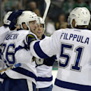 Tampa Bay Lightning's Nikita Kucherov (86), of Russia, is congratulated by Valtteri Filppula (51), of Finland, and the rest of the line after his goal against the Dallas Stars in the second period of a preseason NHL hockey game, Tuesday, Sept. 30, 2014, i