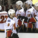 Calgary Flames' Dennis Wideman (6) is congratulated by teammates after scoring a goal against the San Jose Sharks during the first period of an NHL hockey game Saturday, Jan. 17, 2015, in San Jose, Calif The Associated Press