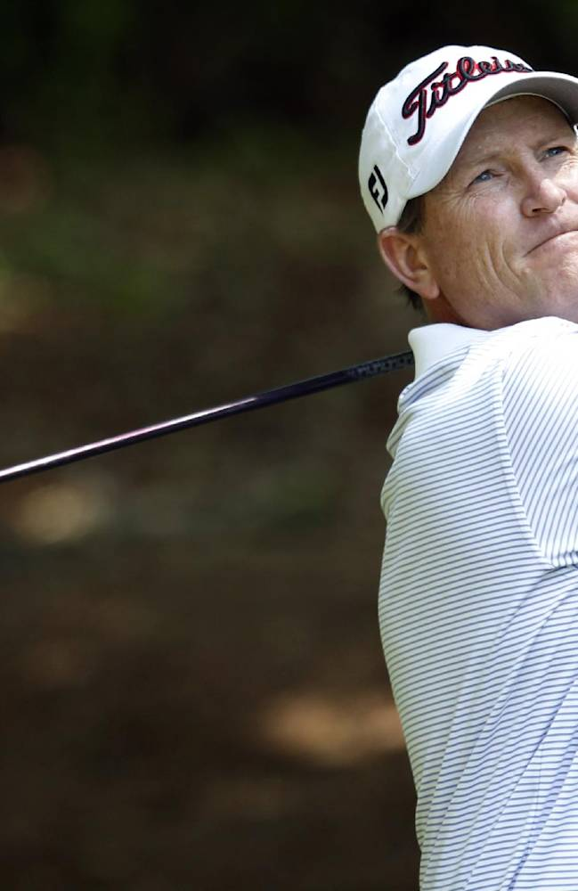 John Inman watches his tee shot on 18 during the third round at the Champions Tour's Regions Tradition golf tournament, Saturday, May 17, 2014, in Birmingham, Ala