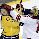 Nashville Predators left wing Viktor Stalberg (25), of Sweden, and Arizona Coyotes defenseman David Schlemko (6) scuffle in the second period of an NHL hockey game Tuesday, Oct. 21, 2014, in Nashville, Tenn The Associated Press