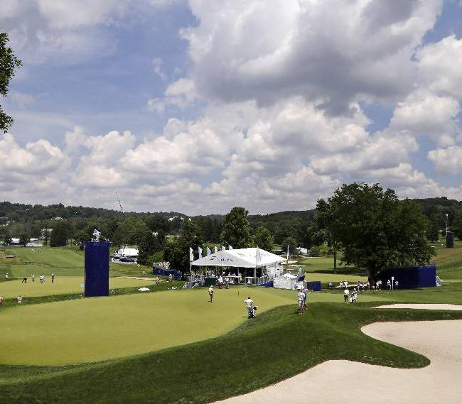 The group of Colin Montgomerie, Jay Haas, and Fred Funk putt on the 12th green during the second round of the Senior Players Championship golf tournament at Fox Chapel Golf Club in Pittsburgh, Friday, June 27, 2014