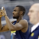 CORRECTS CITY TO ARLINGTON, TEXAS; NOT DALLAS - Michigan's Tim Hardaway Jr. takes pictures during practice for a regional semifinal game in the NCAA college basketball tournament, Thursday, March 28, 2013, in Arlington, Texas. Michigan faces Kansas on Friday. (AP Photo/David J. Phillip)