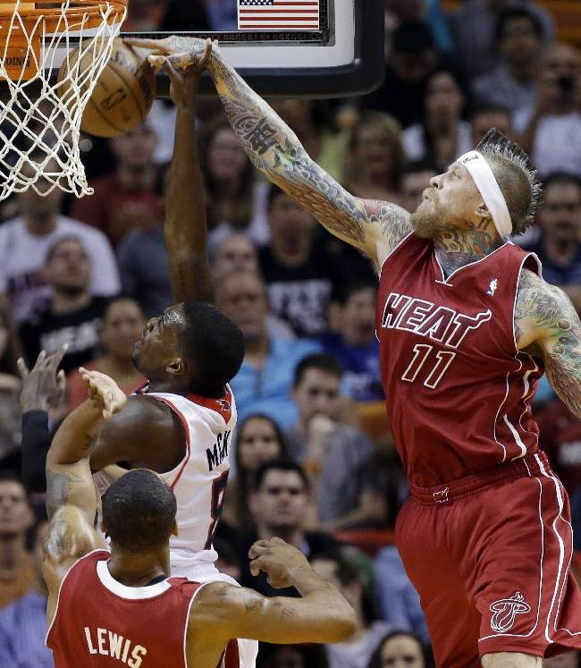 Heat rally past Hawks, 121-119 in OT