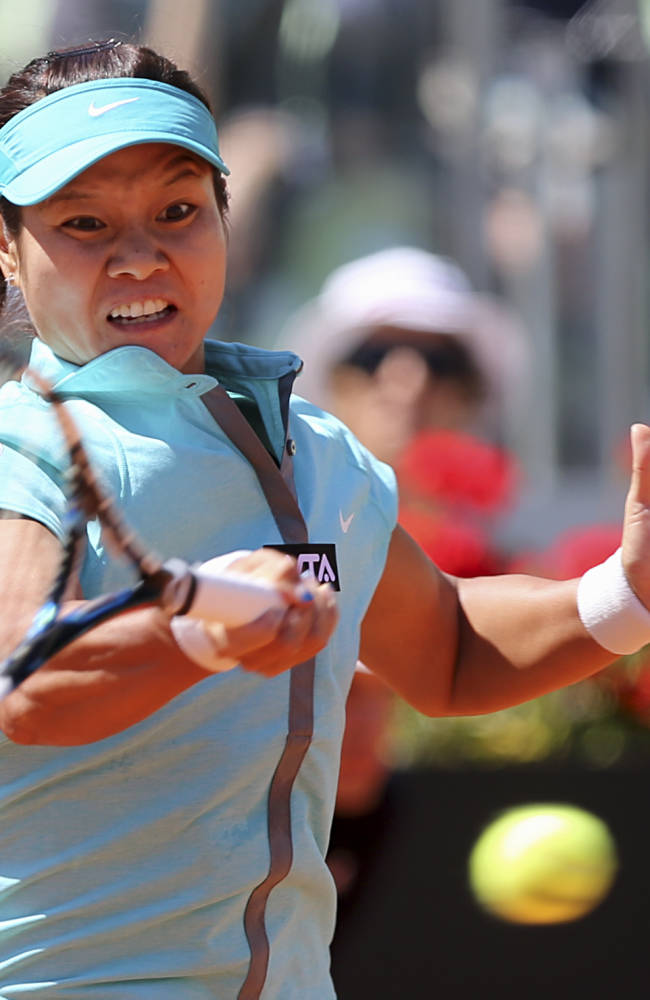 China's Na Li returns the ball to Australia's Samantha Stosur during their match at the Italian open tennis tournament in Rome, Thursday, May 15, 2014