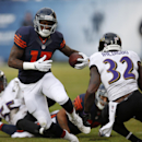 Chicago Bears wide receiver Alshon Jeffery (17) gains yardage after making a reception during the first half of an NFL football game, Sunday, Nov. 17, 2013, in Chicago. At right is Baltimore Ravens safety James Ihedigbo (32) The Associated Press