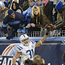 Indianapolis Colts running back Donald Brown (31) hands the ball to a fan after scoring a touchdown on an 11-yard run against the Tennessee Titans in the fourth quarter of an NFL football game Thursday, Nov. 14, 2013, in Nashville, Tenn. The Colts won 30-