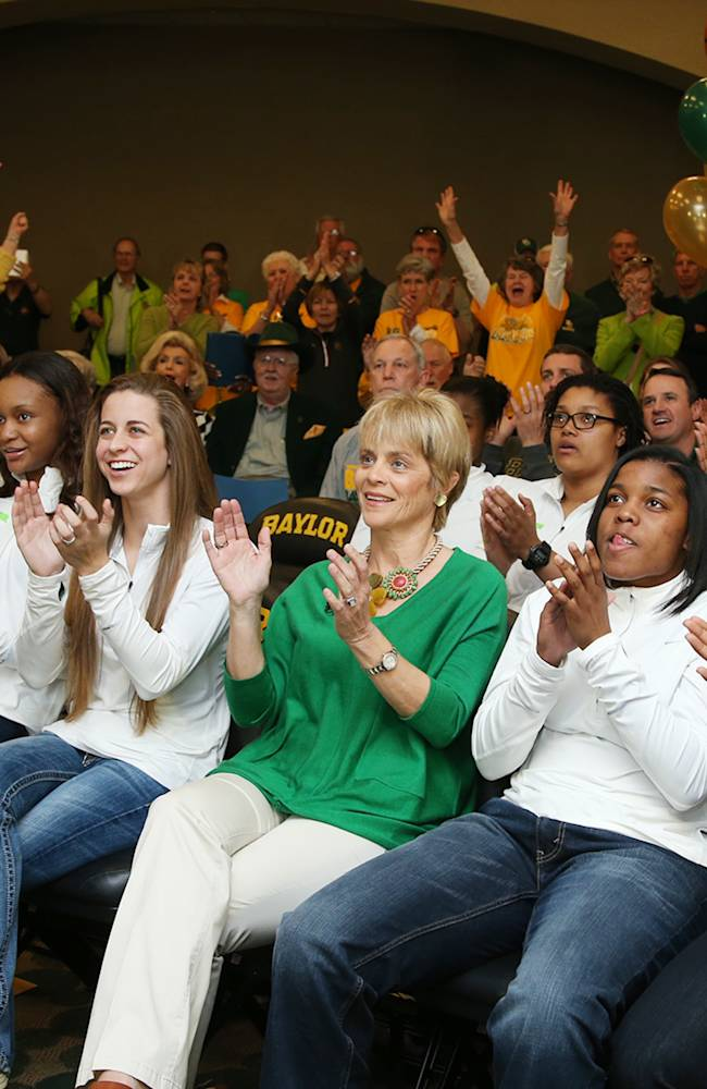 Baylor head coach Kim Mulkey, center watches the NCAA selection show with players  Mariah Chandler,  Nina Davis, Makenzie Robertson, Niya Johnson, and  Odyssey Sims, right during the NCAA selection process, Monday, March 17, 2014, in Waco, Texas
