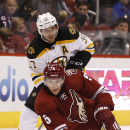 Arizona Coyotes' Connor Murphy (5) gets tripped up by Boston Bruins' Patrice Bergeron (37) during the second period of an NHL hockey game Saturday, Dec. 6, 2014, in Glendale, Ariz The Associated Press