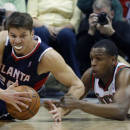 Milwaukee Bucks' Khris Middleton, right, and Atlanta Hawks' Kyle Korver go after a loose ball during the first half of an NBA basketball game on Wednesday, April 16, 2014, in Milwaukee. (AP Photo/Morry Gash)