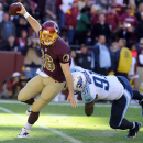 Washington Redskins quarterback Colt McCoy (16) avoids Tennessee Titans outside linebacker Derrick Morgan (91) during the second half of an NFL football game, Sunday, Oct. 19, 2014, in Landover, Md. The Redskins won 19-17. (AP Photo/Richard Lipski)
