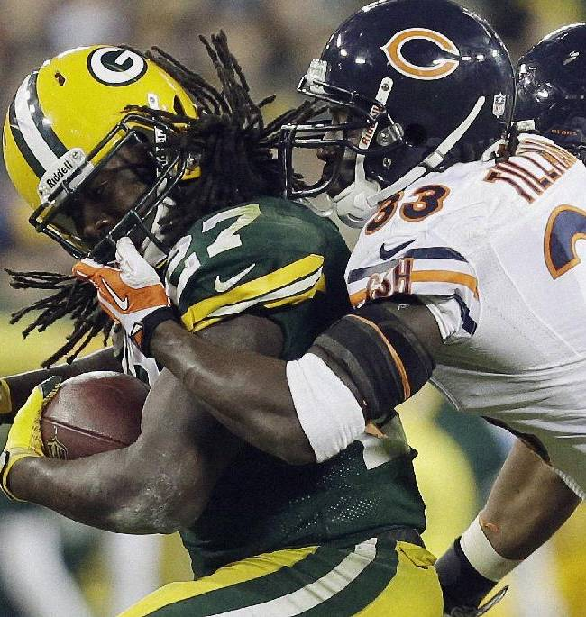 Chicago Bears' Charles Tillman (33) grabs the face mask of Green Bay Packers' Eddie Lacy during the second half of an NFL football game Monday, Nov. 4, 2013, in Green Bay, Wis. The Bears won 27-20