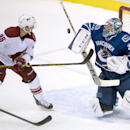 Arizona Coyotes left wing Rob Klinkhammer (36) tries to get a shot past Vancouver Canucks goalie Ryan Miller (30) during the third period of an NHL hockey game in Vancouver, British Columbia, Monday, Sept. 29, 2014 The Associated Press