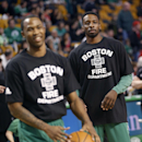 Boston Celtics's Jeff Green, right, wears a Boston Fire Department t-shirt with teammates before an NBA basketball game against the Chicago Bulls in Boston, Sunday, March 30, 2014 The Associated Press
