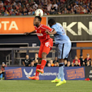 IMAGE DISTRIBUTED FOR GUINNESS INTERNATIONAL CHAMPIONS CUP - Defender Dedryck Boyata (38) of Manchester City and forward Daniel Sturridge (15) of Liverpool FC go up for a header during the Guinness International Champions Cup on Wednesday, July 30, 2014 a