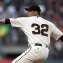 San Francisco Giants starting pitcher Ryan Vogelsong throws to the Washington Nationals during the first inning of a baseball game on Monday, May 20, 2013 in San Francisco. (AP Photo/Marcio Jose Sanchez)