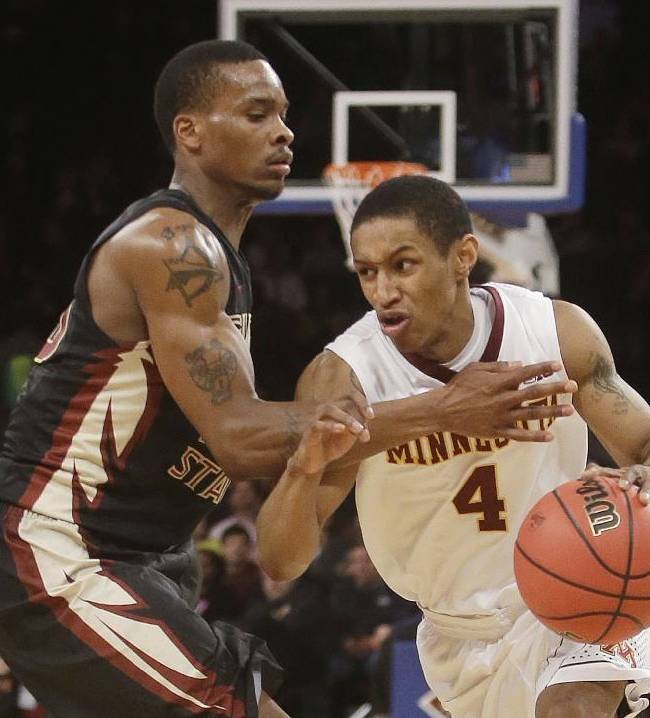 Minnesota's Deandre Mathieu (4) drives past Florida State Seminoles's Aaron Thomas (25) during the first half of an NCAA college basketball game in the semifinals of the NIT Tuesday, April 1, 2014, in New York