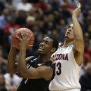 San Diego State guard Xavier Thames, left, drives past Arizona forward Rondae Hollis-Jefferson during the first half of an NCAA men's college basketball tournament regional semifinal, Thursday, March 27, 2014, in Anaheim, Calif The Associated Press
