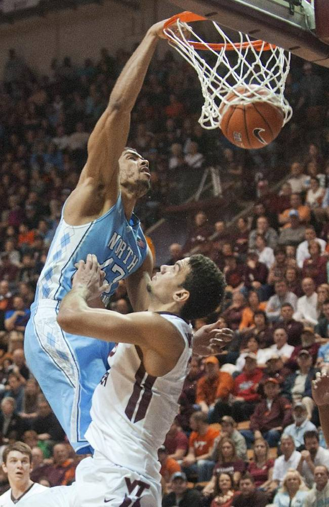 North Carolina's  James McAdoo dunks the ball against Virginia Tech's Joey van Zegeren during the second half of an NCAA college basketball game, Saturday, March 1, 2014, in Blacksburg, Va. North Carolina won 60-56