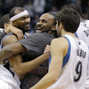 Minnesota Timberwolves forward Corey Brewer, left, celebrates with teammates Ronny Turiaf, center, of France; Ricky Rubio (9), of Spain; and Gorgui Dieng (5) after the Timberwolves defeated the Houston Rockets 112-110 in an NBA basketball game in Minneap