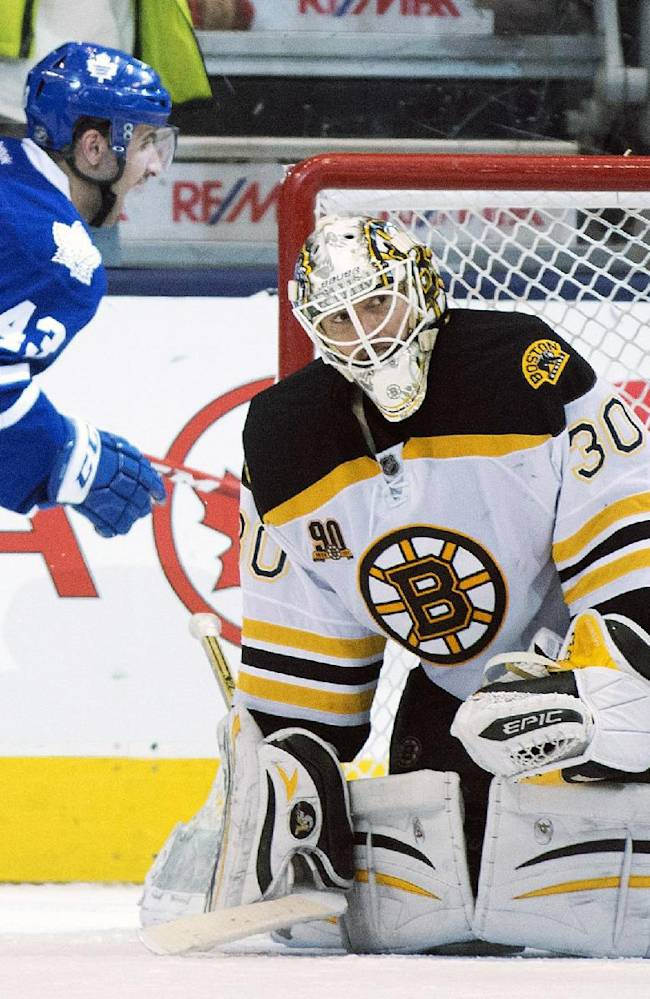 Boston Bruins goaltender Chad Johnson reacts as Toronto Maple Leafs center Nazem Kadri celebrates his game winning overtime goal in an NHL hockey game in Toronto on Thursday, April 3, 2014