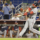 Washington Nationals' Bryce Harper hits a triple to score Jayson Werth during the first inning of the MLB National League baseball game against the Miami Marlins, Monday, April 14, 2014, in Miami The Associated Press