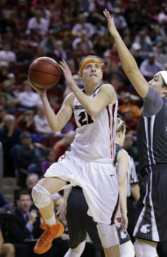 Oregon State's Sydney Wiese, left, tries to shoot as Washington State's Hana Potter defends during the first half of an NCAA college basketball game in the Pac-12 women's tournament Saturday, March 8, 2014, in Seattle
