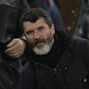Roy Keane, assistant manager of the Republic of Ireland national football team, takes his seat before the English Premier League soccer match between Everton and Queens Park Rangers at Goodison Park Stadium, Liverpool, England, Monday Dec. 15, 2014