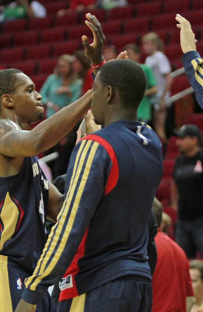 New Orleans Pelicans forward Lance Thomas is congratulated by teammates during play against the Houston Rockets during the second half of a preseason NBA basketball game in Houston, Saturday, Oct. 5, 2013. The Pelicans won the game 116-115