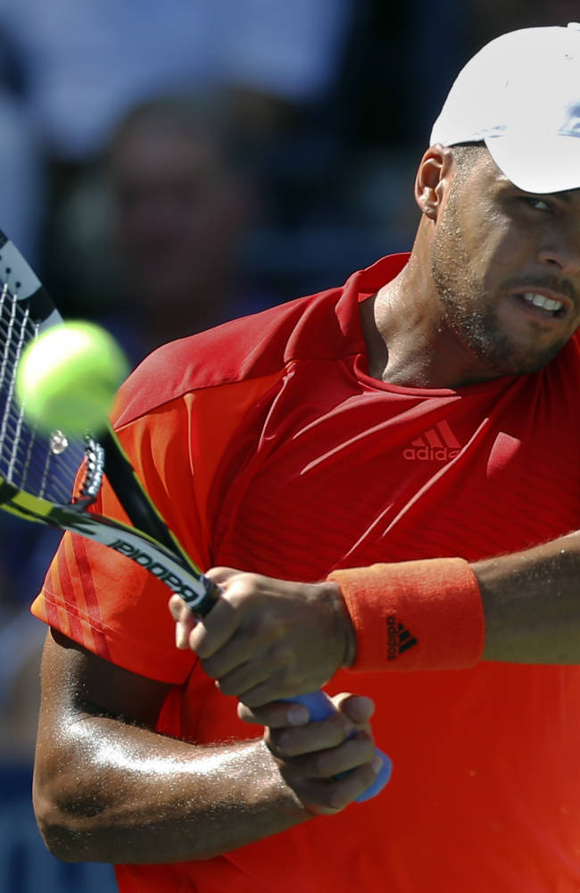 Jo-Wilifried Tsonga, of France, returns a shot to Aleksandr Nedovyesov, of Kazakhstan, during the second round of the 2014 U.S. Open tennis tournament, Thursday, Aug. 28, 2014, in New York