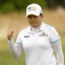 Inbee Park of South Korea reacts after making a birdie putt on the 6th hole during the second round of the 2013 U.S. Women's Open golf championship at the Sebonack Golf Club in Southampton, New York June 28, 2013. REUTERS/Adam Hunger