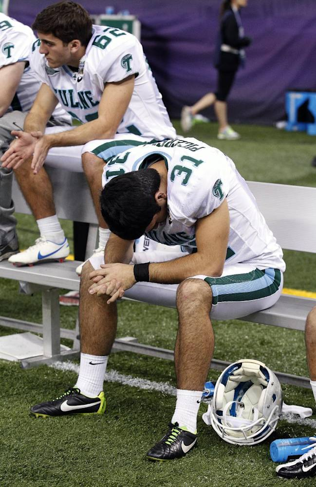 Tulane punter Peter Picerelli (31) sits on the bench near the end of the second half of the New Orleans Bowl NCAA college football game, in New Orleans, Saturday, Dec. 21, 2013. Louisiana-Lafayette defeated Tulane 24-21
