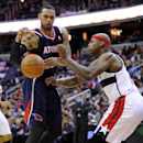 Atlanta Hawks forward Mike Scott, left, loses the ball as he was fouled by Washington Wizards forward Al Harrington, right, during the first half of an NBA basketball game, Saturday, March 29, 2014, in Washington The Associated Press