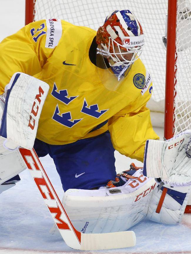 Sweden's goalie Anders Nilsson in action during the Group A preliminary round match against Norway at the Ice Hockey World Championship in Minsk, Belarus, Tuesday, May 13, 2014